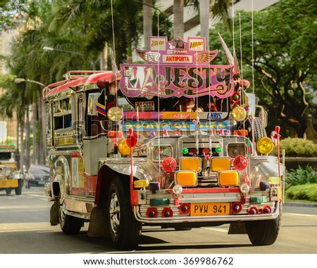 MANILA, PHILIPPINES - JAN 26: Jeepneys are popular public transportation in the Philippines where this photo was take on 26 Jan 2016 and they are originally made from U.S. military jeeps. - stock photo