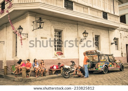 MANILA, PHILIPPINES - 29 JANUARY, 2014: everyday street life in the district of Intramuros, which was the seat of the government when the Philippines were a component of the Spanish Empire. - stock photo