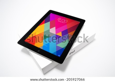 Manila,Philippines - July 17, 2014:  Apple Ipad 4th generation (Retina Display) with iOS 7. iOS 7 new operation system from Apple Inc. It was released on September 18, 2013. - stock photo