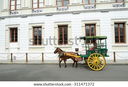 MANILA, PHILIPPINES - MAR 18, 2015. Horse with carriage in Intramuros, Manila, Philippines. Intramuros is the oldest district and historic core of Manila, capital of the Philippines.