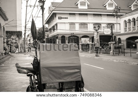 Manila, Philippines - May 3, 2009: Rickshaw driver takes rest while waiting for customers in Intramuros, aka Walled City, in Manila, Philippines