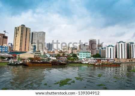 Manila's cityscape view from Media Naranja the large semicircular gun platform in Fort Santiago,  Intramuros district of Manila, Philippines. - stock photo