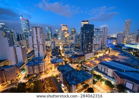 Manila Skyline. Eleveted, night view of Makati, the business district of Metro Manila.  - stock photo