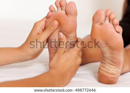 Manipulating a female feet