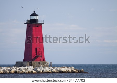 Manistique Pier Lighthouse - stock photo