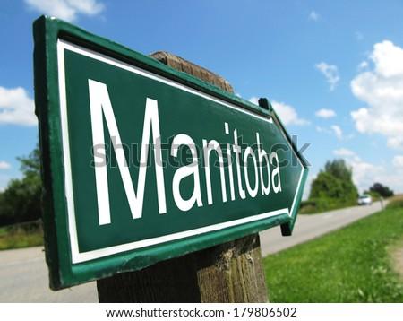 Manitoba signpost along a rural road - stock photo
