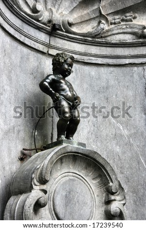 Manneken Pis, also known in French as the petit Julien. Famous statue of peeing boy in Brussels, Belgium. - stock photo