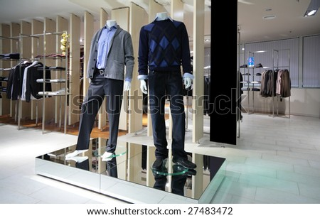 Manneqiuns in section of men clothes in shop - stock photo