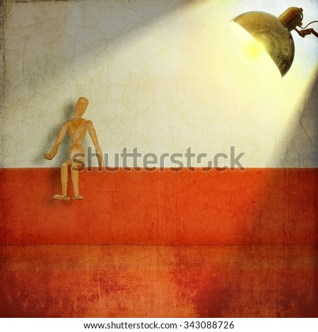 Mannequin by painter sitting lit by a lamp. - stock photo