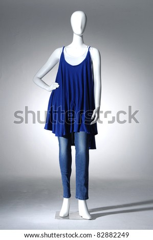 Mannequin dressed in fashion shirt and blue jeans on light background - stock photo