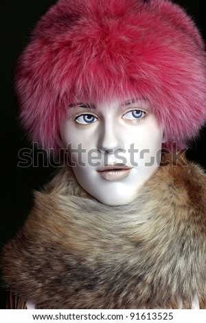 mannequin head wearing fur hat and collar