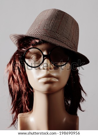 mannequin head with wig, hat and glasses - stock photo