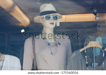 Mannequin in a shop window - stock photo