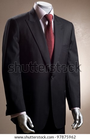 mannequin in a suit, shirt and tie - stock photo