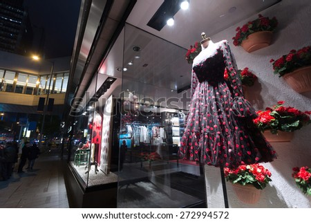 mannequin in fashion shop display window - stock photo