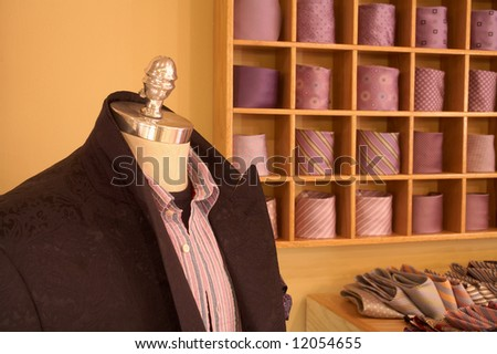 Mannequin in interior of upscale men's clothing shop