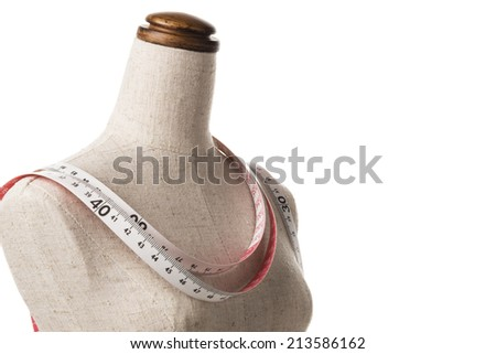 mannequin with a tape measure, close-up - stock photo