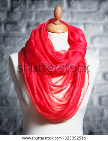 Mannequin with silk cloth. Knitted fashion red organza shawl on tailor bust - stock photo