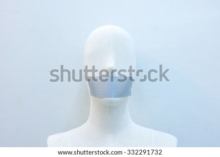 mannequins gagged with tape - stock photo