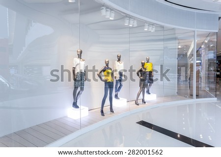 Mannequins in fashion shopfront - stock photo