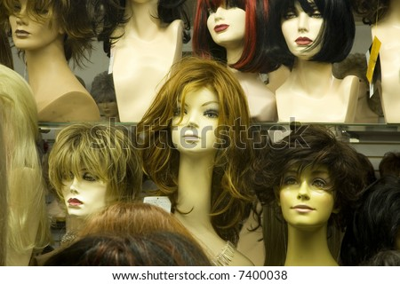 Mannikin heads in a wig store - stock photo
