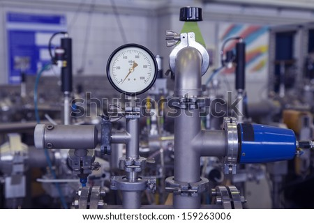 Manometer, precise instrument in nuclear laboratory, close up, selective focus, industrial blue toned   - stock photo