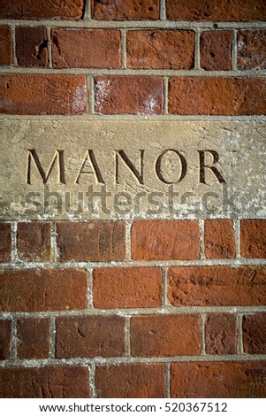 Manor carved sign at English grand residence