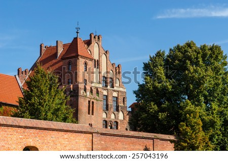 Manor House in Torun, Poland. Gothic building used as a summer residence of the Brotherhood of St. George, listed on UNESCO site. - stock photo