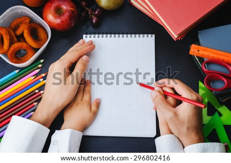 Mans hand holding a childs hand with pencil. School concept. the toning. selective focus - stock photo