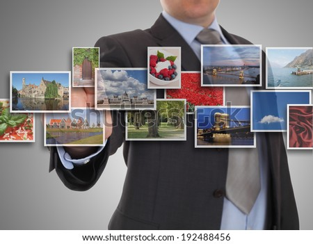 Mans hand reaching one of images streaming - stock photo