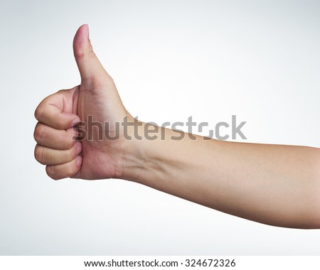 mans hand showing close up of the thumbs up sign on white background, with clipping path - stock photo
