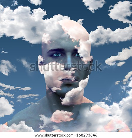 Mans head in clouds - stock photo