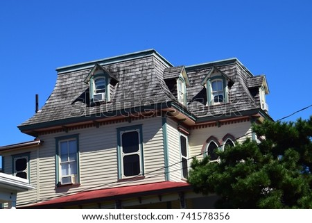 Mansard roof stock images royalty free images vectors for Mansard style homes