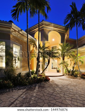 Mansion entrance in a tropical location. - stock photo