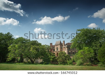 Mansion through the trees on a summers day - stock photo