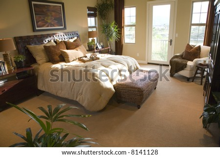 Mansion with spacious bedroom and lounge area. - stock photo