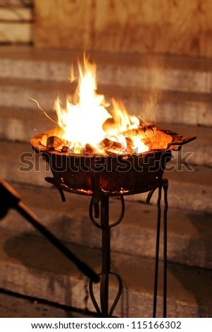 MANTOVA, ITALY - APRIL 03: Looking at the lighting of the holy flame during Easter celebrations outside the cathedral of St. Andrew April 03, 2010 in Mantova, Italy.