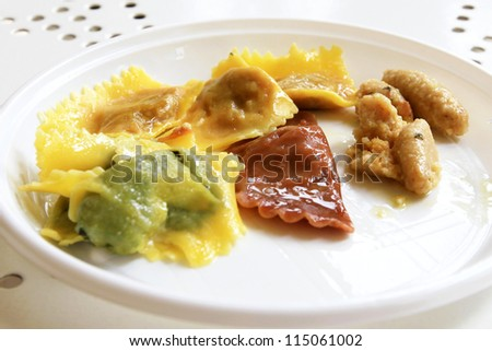 MANTOVA, ITALY - JUNE 13: Different kind of pumpkin hand made tortelli during Golosaria, fair show of food and gastronomy culture June 13, 2010 in Mantova, Italy. - stock photo