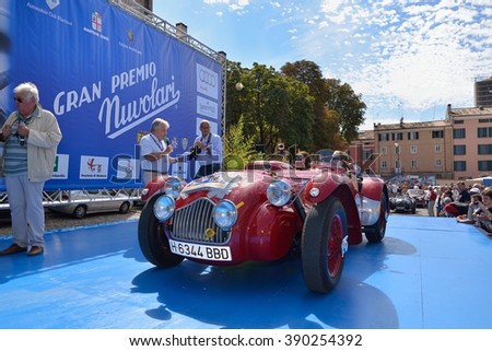 MANTOVA (MN), ITALY - SEPTEMBER 18: A red Allard J2X takes part to the GP Nuvolari classic car race on September 18, 2015 in Mantova (MN). The car was built in 1952. - stock photo