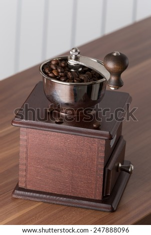 manual burr-mill for milling the coffee seeds - stock photo