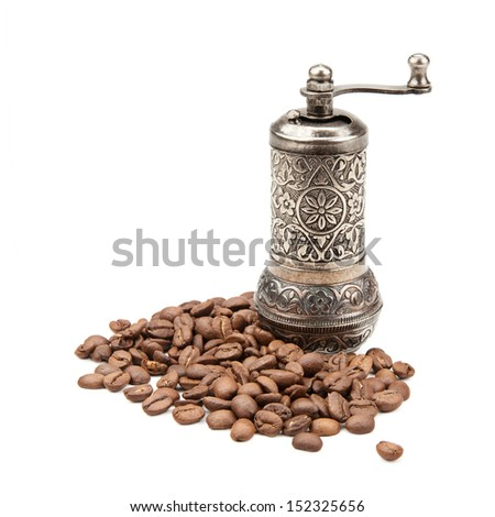 manual coffee grinder and coffee beans isolated on white background - stock photo