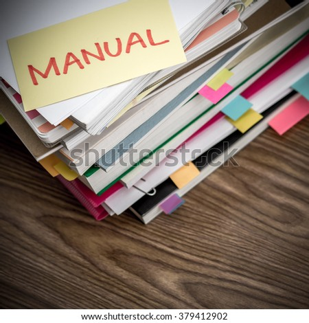 Manual; The Pile of Business Documents on the Desk - stock photo