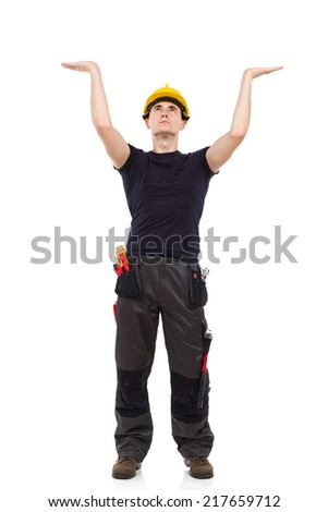 Manual worker acting holding something above his head. Full length studio shot isolated on white. - stock photo
