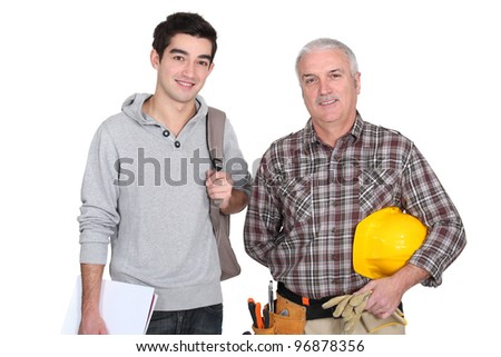 Manual worker and apprentice - stock photo