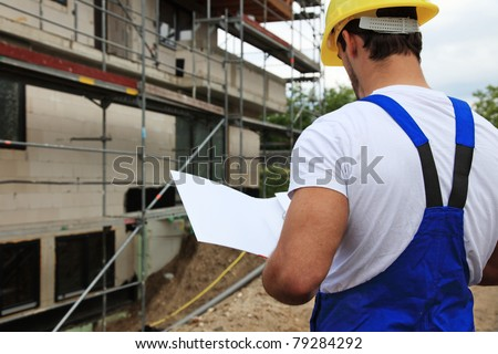 Manual worker on construction site during building inspection. - stock photo