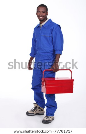 Manual worker with a red toolbox - stock photo