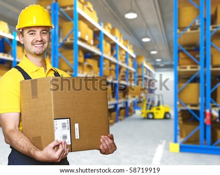 manual worker with parcel and warehouse parcel - stock photo