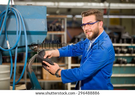Manual worker working in factory. - stock photo