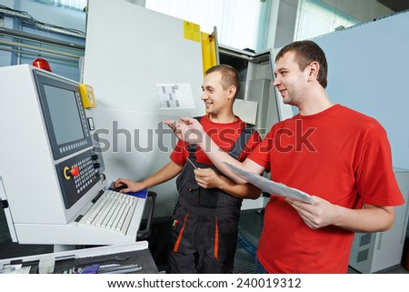 manufacture technician workers with discussing detail at factory metal machining shop - stock photo