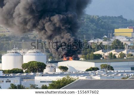 manufactures burning in Montornes Del Valles - stock photo